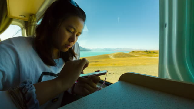 Woman using smartphone video