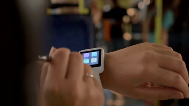 Woman using smartwatch in the bus video