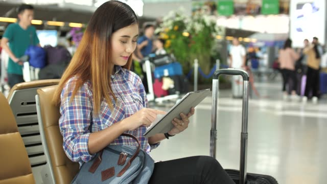 Woman Using Tablet at Airport video