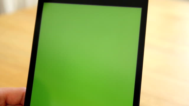 Woman Using Tablet w/Various Hand Gestures - Green Screen A woman swipes a tablet and does various touch screen motions to the screen. Framing is close up so we see her hands and fingers. Tablet is chroma key (green screen) ready! pinching stock videos & royalty-free footage