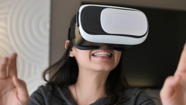 woman using vr glasses - rzeczywistość witrualna filmów i materiałów b-roll