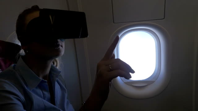 Woman using VR headset in the plane video