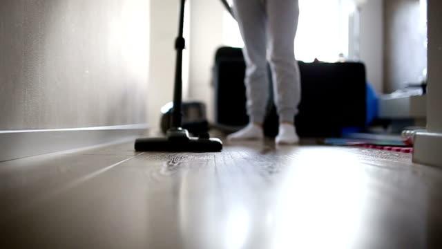 Woman vacuuming her living room video