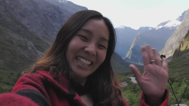 woman video call to friend fro travel trip - cultura orientale video stock e b–roll