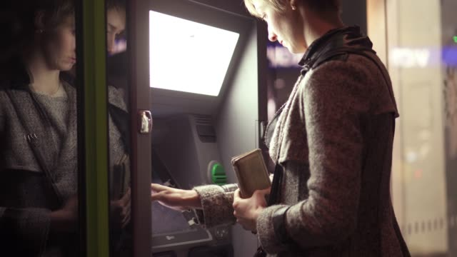 atm woman - frugal lifestyle stock videos and b-roll footage
