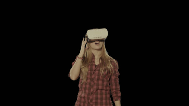 Woman virtual reality headset. Isolated clip alpha channel available in 4k version video