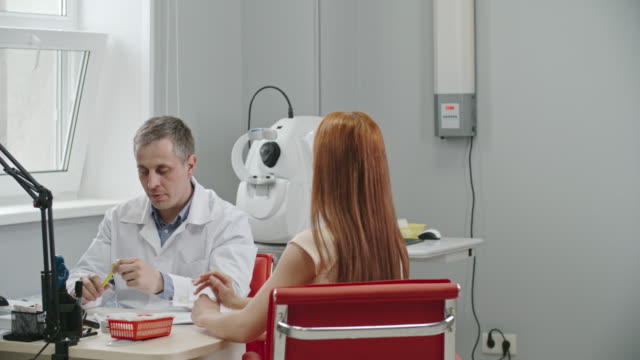 Woman Visiting Office of Optometrist video