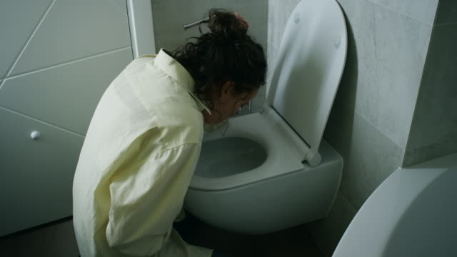 Woman Vomiting In Bathroom video