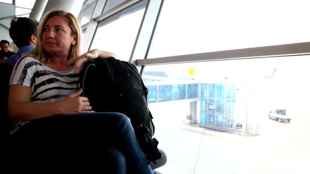 Woman waiting at the airport video