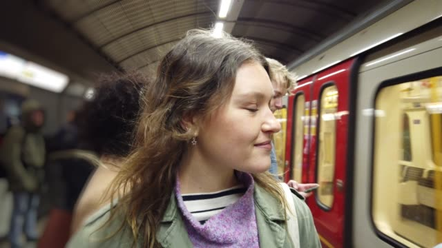 Woman waiting for the subway train - video