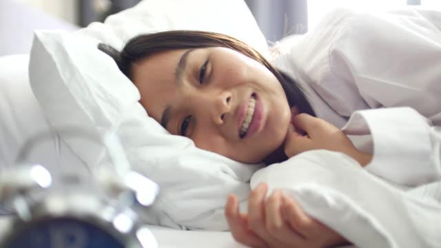 Woman wake up and smailing Looking at camera video