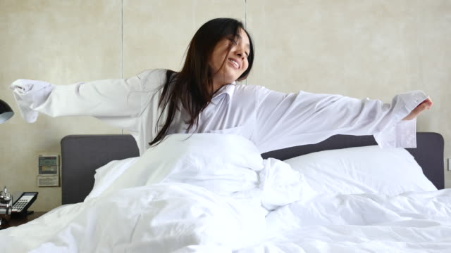 Woman wake up refreshed on morning in Bedroom video