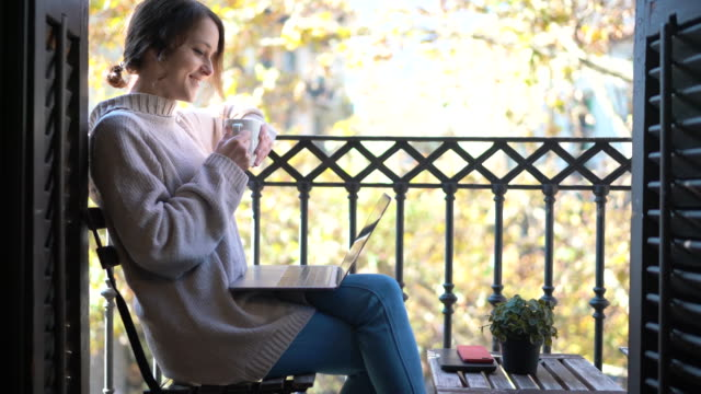 woman waking up with cup of coffee at the terrace - balcone video stock e b–roll