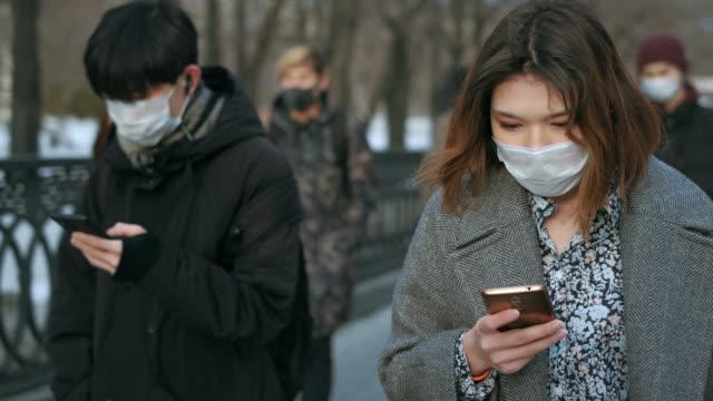 Woman Walk White Mask. Coronavirus Epidemic. Pandemic Crowd People. Quarantine. video