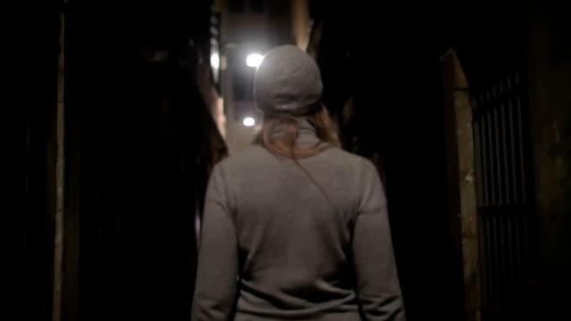 Woman Walking Along the Narrow Street video