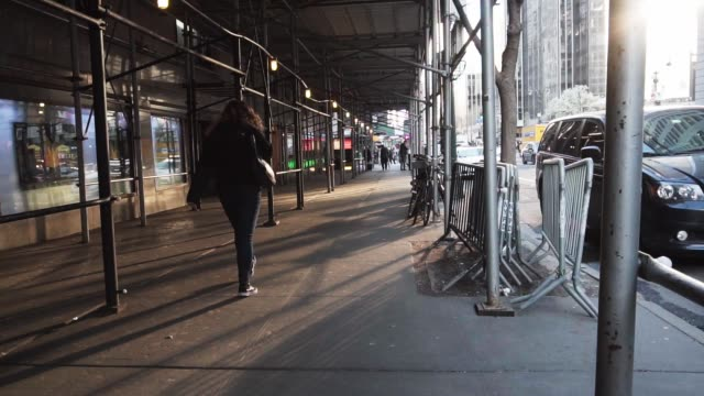 Woman Walking Downtown NYC Golden Hour