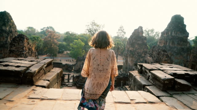 woman walking    in angkor temple in cambodia - tempio video stock e b–roll
