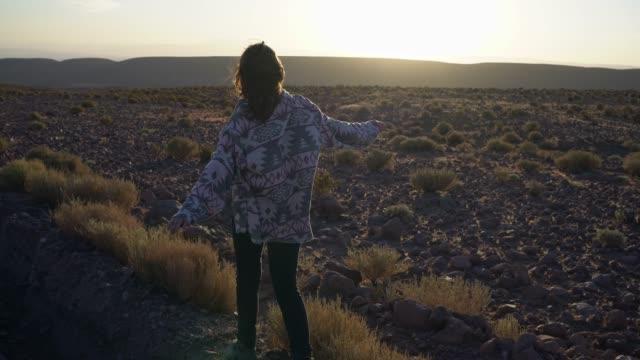 Woman walking in Atacama desert in Chile