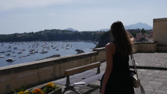 woman walking in procida, italy - procida video stock e b–roll