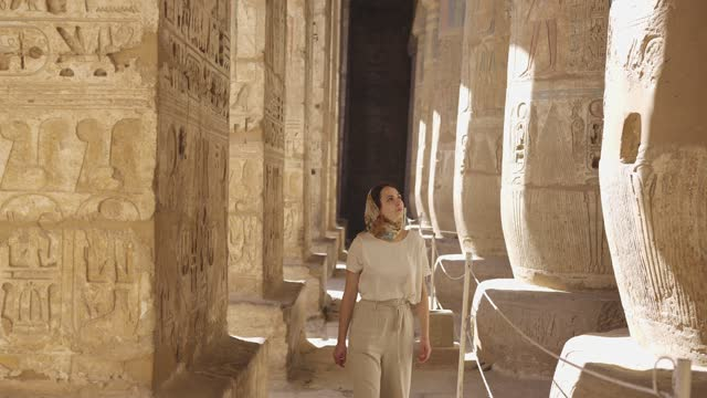 Woman walking in the ancient Egyptian temple in Luxor