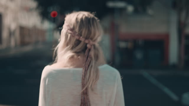 Woman walking in urban setting video