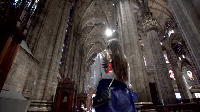 woman walking inside the milan cathedral - italian architecture stock videos & royalty-free footage