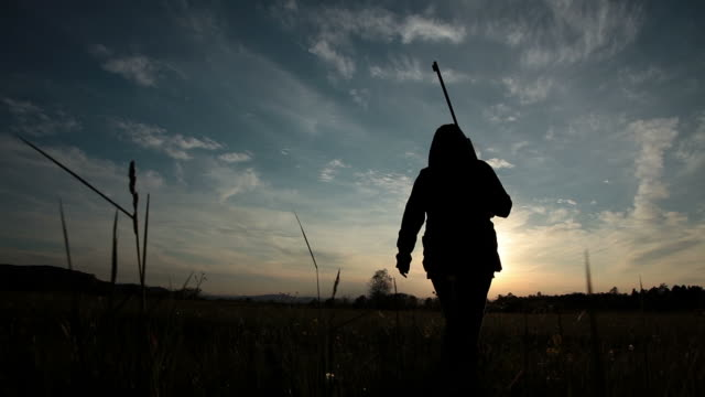 HD - Woman Walking into Sunset with Rifle video