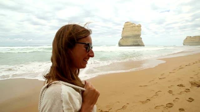 Woman walking on beach at Gibsons steps, Great Ocean Road video