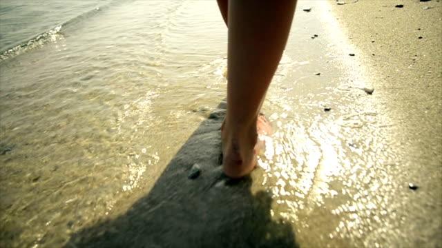 Woman walking on beach video