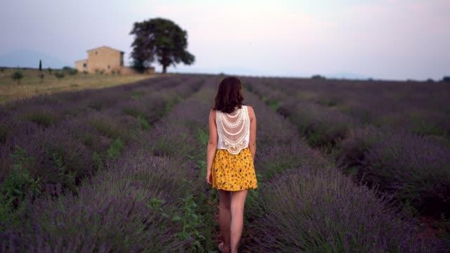 Woman walking on  lavender field in Provence