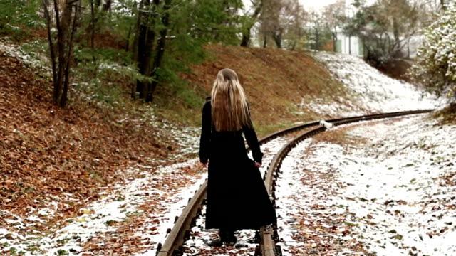 Woman walking on railway tracks video