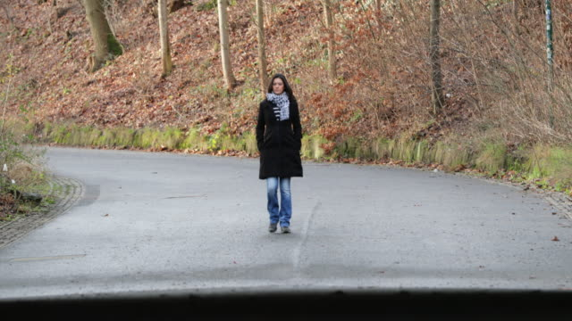 Woman walking on road during winter season, Concept of destiny road destination journey and path to life