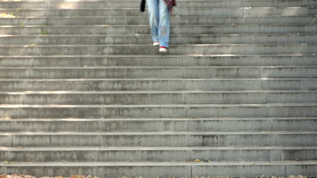 Woman walking on stone staircase video