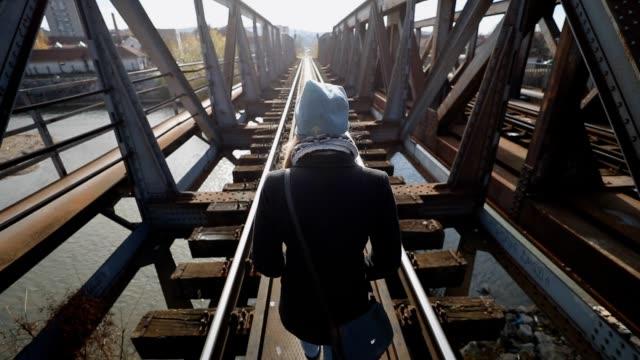Woman walking on the bridge