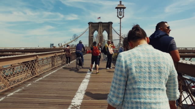 Woman walking on the Brooklyn bridge video