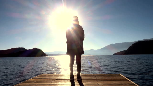 woman walking to lake on wooden pier - molo video stock e b–roll