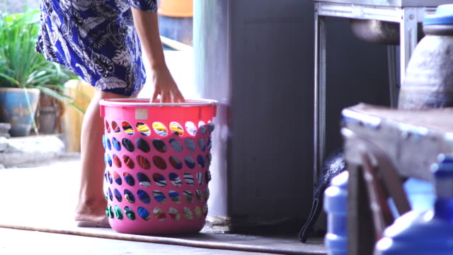 Woman washing clothes Video format  Woman washing clothes. laundry basket stock videos & royalty-free footage