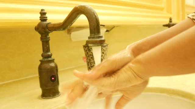 Woman washing hands with soap video