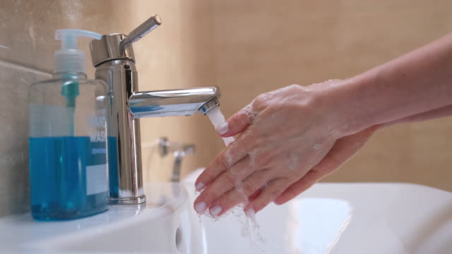 woman washing her hands - igiene video stock e b–roll
