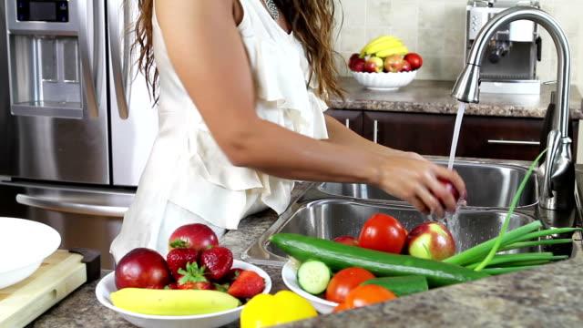 Woman washing vegetables video