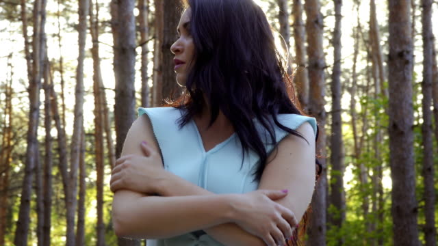 Woman wave off from insects in the forest video