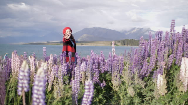 Woman waving hand in Lupine Flower video
