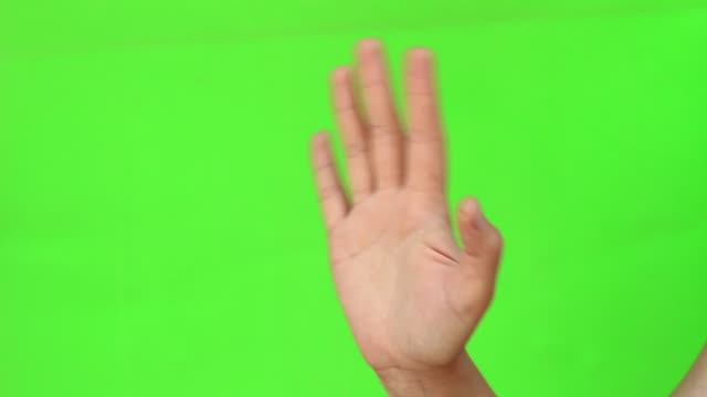 woman waving hand saying hello and hi gesture - machać filmów i materiałów b-roll