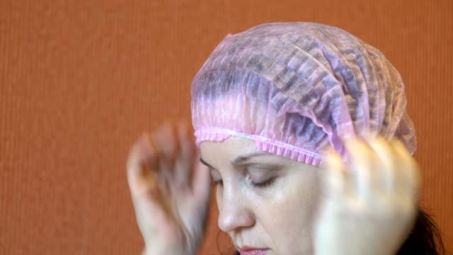 woman wearing a pink hat - flu shot стоковые видео и кадры b-roll