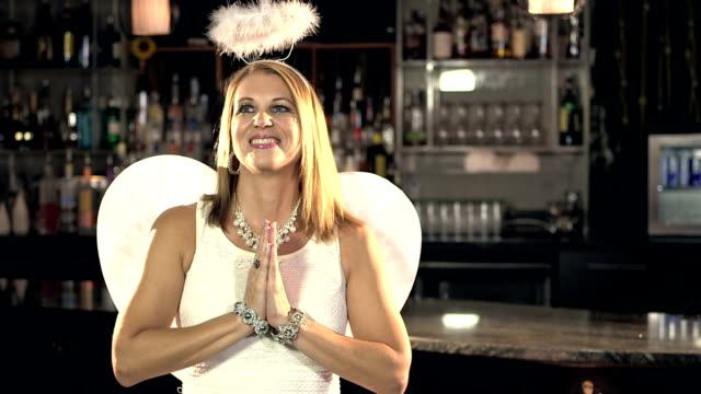Woman wearing angel costume video