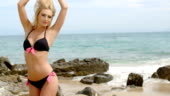 9d69d1d9b22 Blond Woman In Thong Bikini Walking On Beach Stock Video & More ...