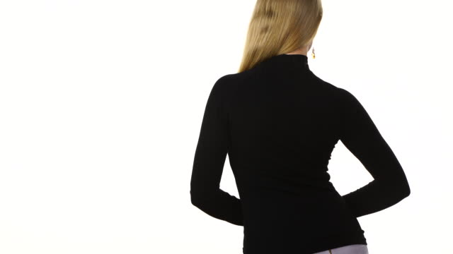 Woman wearing black long sleeve top rear view Unrecognizable woman wearing fashionable clothing black long sleeve top, back view, isolated on white, text area. Fashion concept. sleeve stock videos & royalty-free footage
