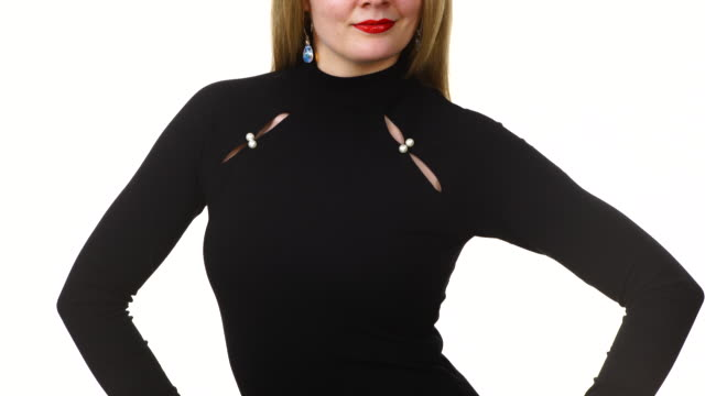 Woman wearing black long sleeve top Woman wearing fashionable clothing black long sleeve neck top decorated with pearls, on white. Fashion concept. sleeve stock videos & royalty-free footage