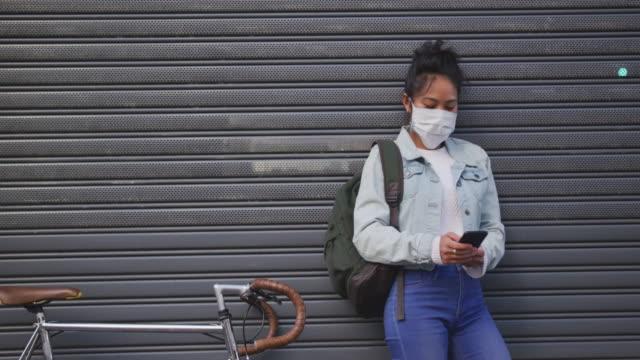Woman wearing medical coronavirus mask on the street