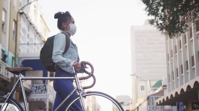 Woman wearing medical coronavirus mask walking on the street